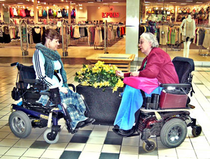 LILA | Two people in wheelchairs at the mall